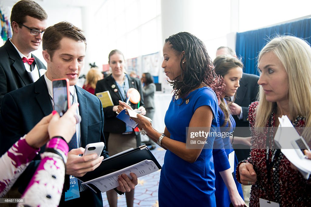 Rep. <a gi-track='captionPersonalityLinkClicked' href=/galleries/search?phrase=Mia+Love&family=editorial&specificpeople=8937528 ng-click='$event.stopPropagation()'>Mia Love</a>, R-Utah, gives an autograph to a CPAC attendee following her appearance on stage at CPAC in National Harbor, Md., on Feb. 26, 2015.