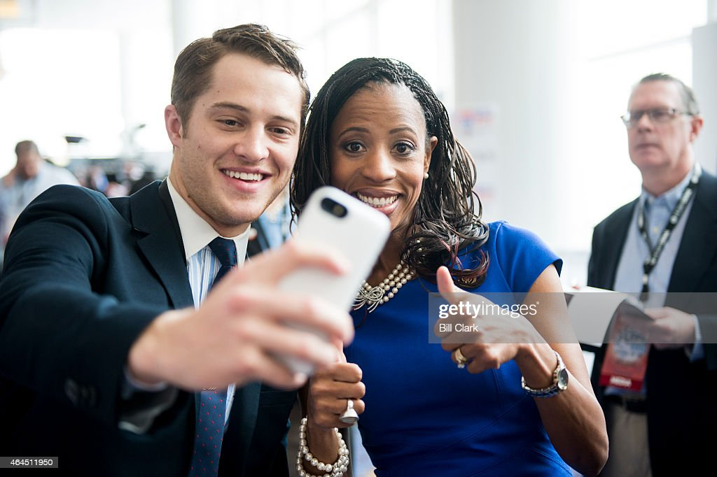 Rep. <a gi-track='captionPersonalityLinkClicked' href=/galleries/search?phrase=Mia+Love&family=editorial&specificpeople=8937528 ng-click='$event.stopPropagation()'>Mia Love</a>, R-Utah, poses for a selfie with a CPAC attendee following her appearance on stage at CPAC in National Harbor, Md., on Feb. 26, 2015.