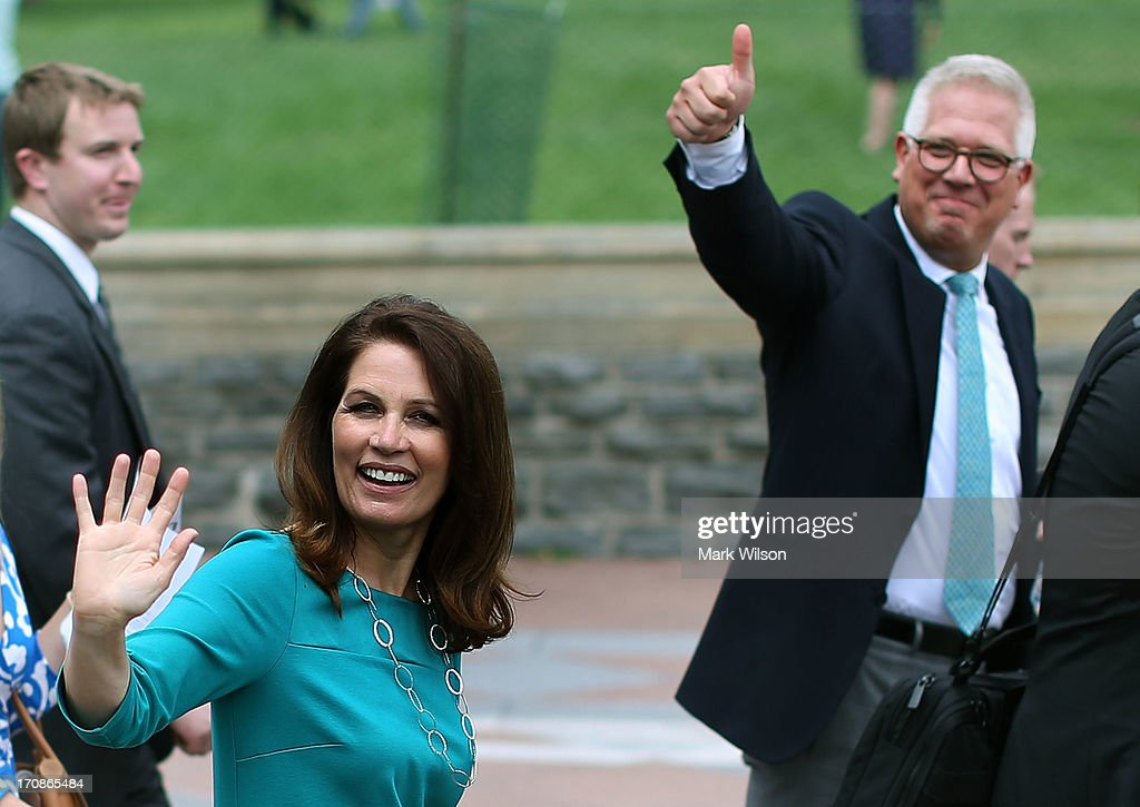 Rep. <a gi-track='captionPersonalityLinkClicked' href=/galleries/search?phrase=Michele+Bachmann&family=editorial&specificpeople=5578664 ng-click='$event.stopPropagation()'>Michele Bachmann</a> (R-MN) and <a gi-track='captionPersonalityLinkClicked' href=/galleries/search?phrase=Glenn+Beck&family=editorial&specificpeople=3267771 ng-click='$event.stopPropagation()'>Glenn Beck</a> wave to supporters at a Tea Party rally in front of the U.S. Capitol, June 17, 2013 in Washington, DC. The group Tea Party Patriots hosted the rally to protest against the Internal Revenue Service's targeting Tea Party and grassroots organizations for harassment.