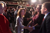 Rep Michele Bachmann greets the family of former US Senator Rick Santorum after a twohour Republican presidential candidate debate in the Stephens...