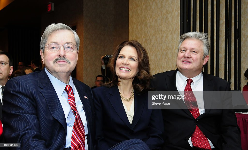 Rep. <a gi-track='captionPersonalityLinkClicked' href=/galleries/search?phrase=Michele+Bachmann&family=editorial&specificpeople=5578664 ng-click='$event.stopPropagation()'>Michele Bachmann</a> (R-MN) (C), her husband Marcus Bachmann (R) and Iowa Gov. <a gi-track='captionPersonalityLinkClicked' href=/galleries/search?phrase=Terry+Branstad&family=editorial&specificpeople=985886 ng-click='$event.stopPropagation()'>Terry Branstad</a> listens to Bachmann's introduction prior to her speach at the Iowans for Tax Relief PAC Watchdog Reception January 21, 2011 in Des Moines, Iowa. Bachmann spoke to Iowa's largest anti-tax group amidst speculation that she will run for president as a Republican candidate in 2012.