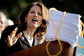 Rep Michele Bachmann leads a news conference and rally on the West Front of the US Capitol November 5 2009 in Washington DC Thousands of people and...