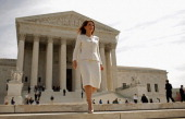 Rep Michele Bachmann leaves the US Supreme Court after the third day of oral arguements over the constitutionality of the Patient Protection and...