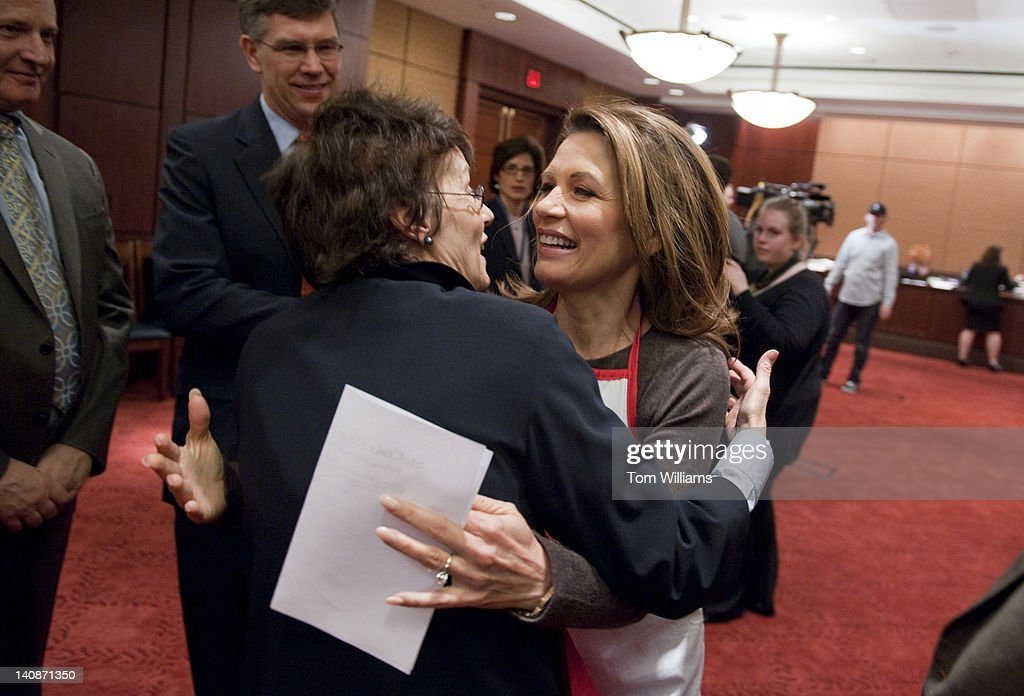 Rep. Michele Bachmann, R-Minn., right, greets Franni Franken, wife of Sen. Al Franken, D-Minn., before the second annual 'hotdish' competition in the Capitol Visitor Center, featuring casserole-like dishes from members of the Minnesota Congressional Delegation. The dishes of Sen. Franken and Rep. Chip Cravaack, R-Minn., tied for first place in the competition.