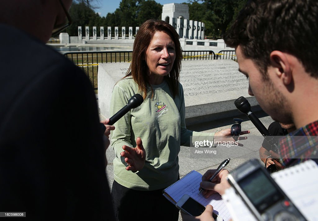 U.S. Rep. <a gi-track='captionPersonalityLinkClicked' href=/galleries/search?phrase=Michele+Bachmann&family=editorial&specificpeople=5578664 ng-click='$event.stopPropagation()'>Michele Bachmann</a> (R-MN) speaks to members of the media outside the World War II Memorial during a government shutdown October 1, 2013 in Washington, DC. The memorial was temporary opened to veteran groups arrived on Honor Flights on a day trip to visit the nation's capital.