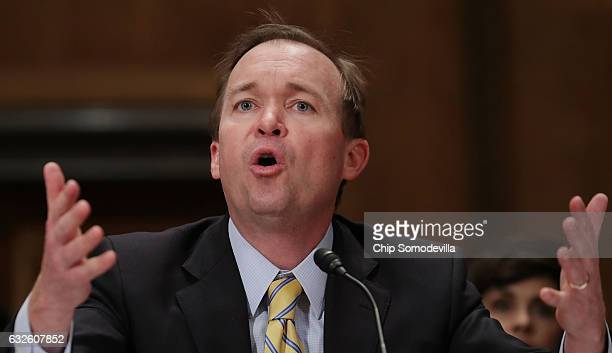 Rep Mick Mulvaney testifies before the Senate Homeland Security and Governmental Affairs Committee during his confirmation hearing to be the next...