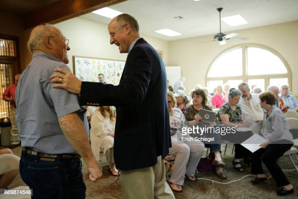 S Rep Mike Conaway greets constituents at a town hall meeting at the Mason County Library on April 18 2017 in Mason Texas Conaway is replacing...