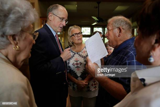 S Rep Mike Conaway listens to constituents at a town hall meeting at the Mason County Library on April 18 2017 in Mason Texas Conaway is replacing...