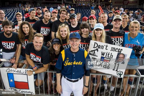 Rep Mike Conaway RTexas poses with fans during the 56th Congressional Baseball Game at Nationals Park on June 15 2017