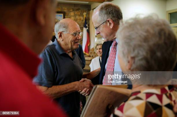 S Rep Mike Conaway shakes hands with constituens at a town hall meeting at the Mason County Library on April 18 2017 in Mason Texas Conaway is...