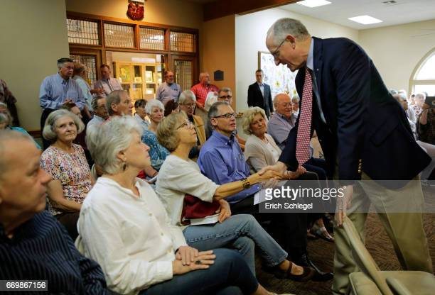 S Rep Mike Conaway shakes hands with constituents at a town hall meeting at the Mason County Library on April 18 2017 in Mason Texas Conaway is...