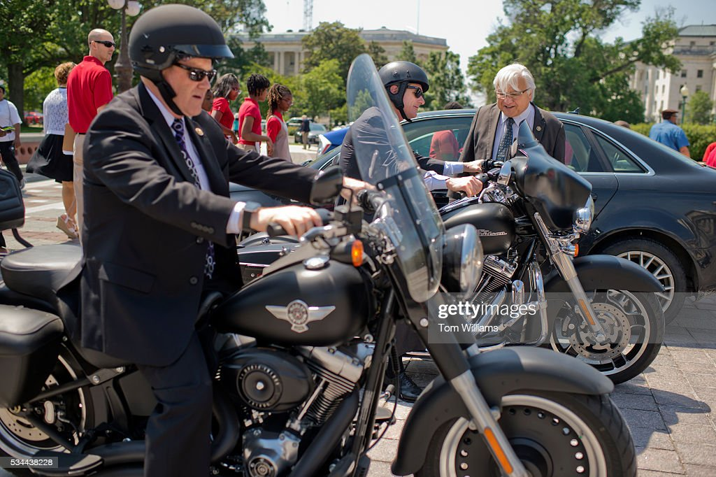 Rep. Mike Honda, D-Calif., checks out the Harley-Davidson motorcycles of Reps. Reid Ribble, R-Wis., left, and Scott Rigell, R-Va., on the East Front of the Capitol after the last votes in the House which begins the Memorial Day recess, May 26, 2016.