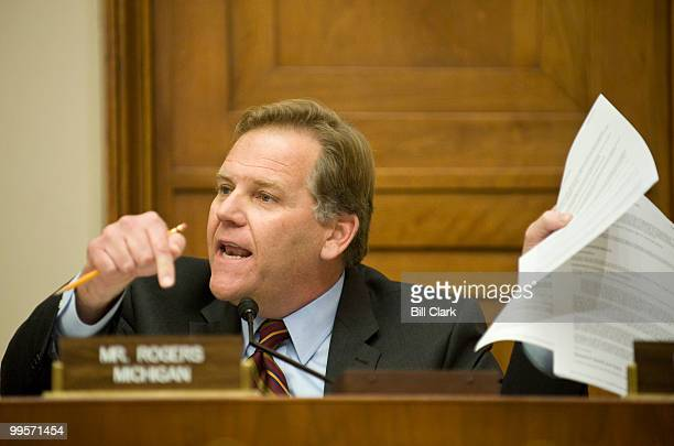 Rep Mike Rogers RMich holds a copy of the new breast cancer screeening recommendations report as he speaks during the House Energy and Commerce...