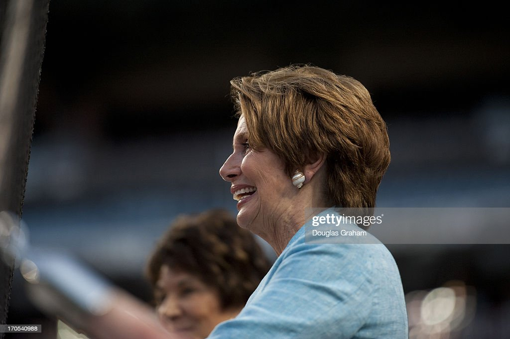 Rep. Nancy Pelosi enjoys the action at the 52nd annual Congressional Baseball Game at National Stadium in Washington on Thursday, June 13, 2013.