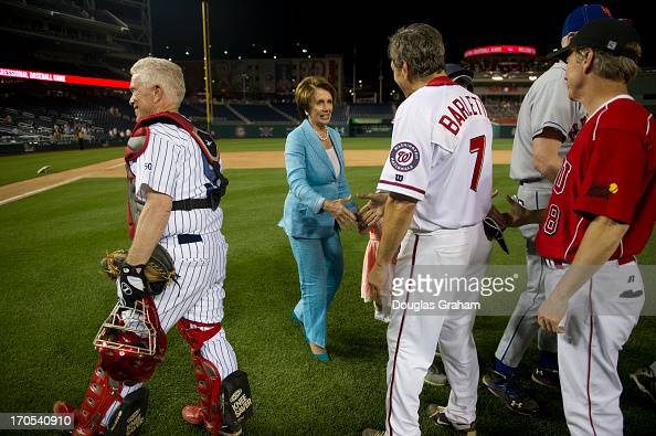 Rep Nancy Pelosi shakes the hands of the defeated GOP team at the 52nd annual Congressional Baseball Game at National Stadium in Washington on...