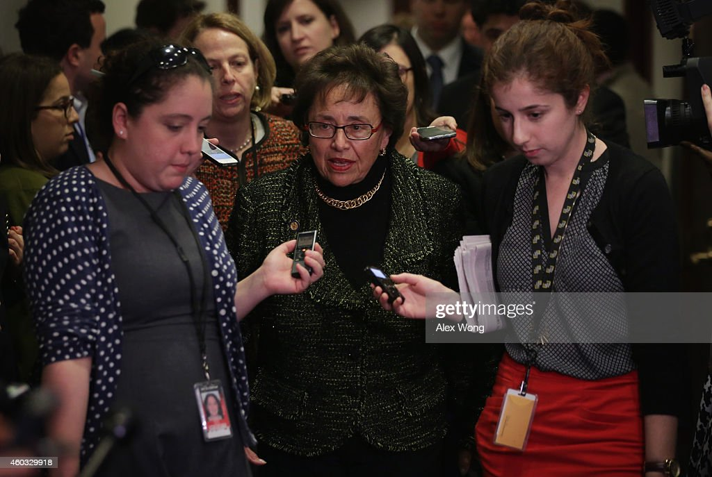 U.S. Rep. <a gi-track='captionPersonalityLinkClicked' href=/galleries/search?phrase=Nita+Lowey&family=editorial&specificpeople=878051 ng-click='$event.stopPropagation()'>Nita Lowey</a> (D-NY) (C) is followed by members of the media as she arrives at a House Democratic Caucus meeting December 11, 2014 on Capitol Hill in Washington, DC. Both houses of Congress are working to avoid a government shutdown at midnight this evening as Republican efforts to pass an omnibus funding bill stalled earlier this afternoon.