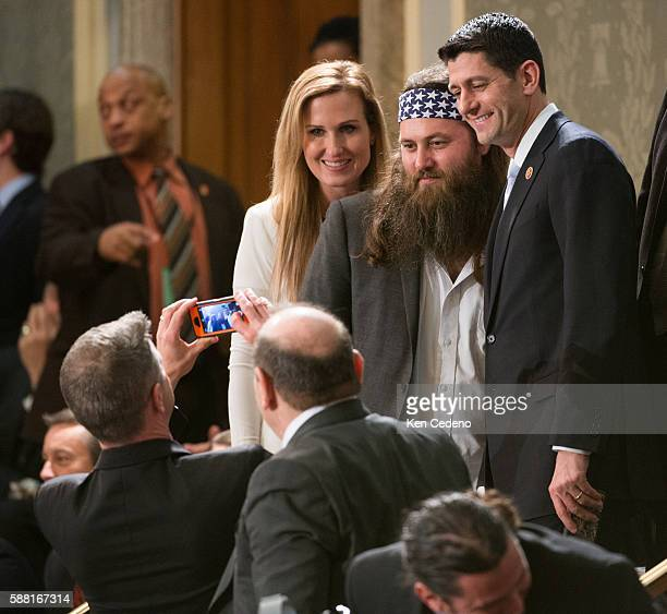 Rep Paul Ryan and Duck Dynasty's Willy Robertson and his wife Korie Howard pose for a photo prior to President Obama giving his State of the Union...
