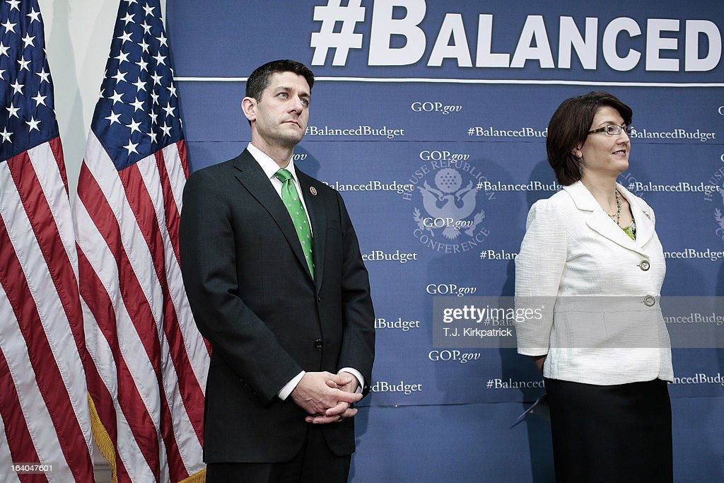 Rep. Paul Ryan (R-WI) (L) and House Republican Conference Chairman Cathy McMorris Rodgers (R-WA) listen to a speaker as House Republican leaders address the media after a party conference on March 19, 2013 in Washington, DC. GOP leaders asked that the president work with them to create a balanced budget plan, citing President Clinton's efforts to work with House Republicans on a budget in the 1990s.