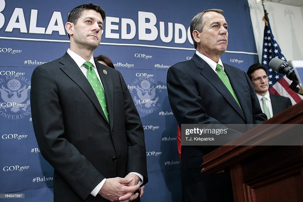 Rep. Paul Ryan (R-WI) (L) and House Speaker John Boehner (R-OH) listen to a question as House Republican leaders address the media after a party conference on March 19, 2013 in Washington, DC. GOP leaders asked that the president work with them to create a balanced budget plan, citing President Clinton's efforts to work with House Republicans on a budget in the 1990s.