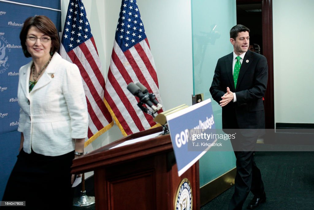 Rep. Paul Ryan (R-WI) (R) heads to the podium following House Republican Conference Chairman Cathy McMorris Rodgers (R-WA) to speak about his new budget plan as House Republican leaders address the media after a party conference on March 19, 2013 in Washington, DC. GOP leaders asked that the president work with them to create a balanced budget plan, citing President Clinton's efforts to work with House Republicans on a budget in the 1990s.