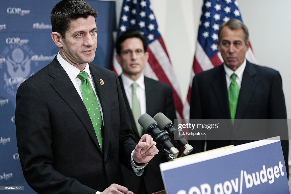 Rep. Paul Ryan (R-WI) (L) speaks about his new budget plan as House Republican leaders address the media after a party conference on March 19, 2013 in Washington, DC. GOP leaders asked that the president work with them to create a balanced budget plan, citing President Clinton's efforts to work with House Republicans on a budget in the 1990s.