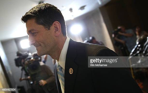 S Rep Paul Ryan walks to a meeting with House Republicans October 20 2015 in Washington DC Ryan remains at the center of the House Republican search...