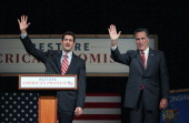S Rep Paul Ryan waves with Republican Presidential candidate and former Massachusetts Gov Mitt Romney after he introduced Romney at a campaign stop...