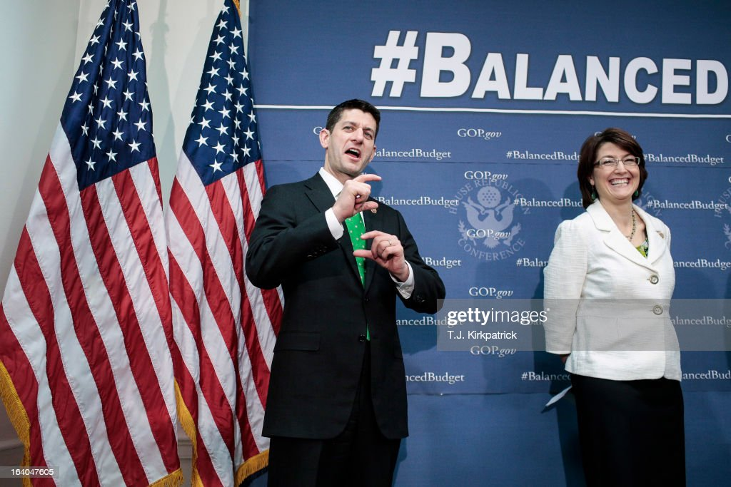Rep. Paul Ryan (R-WI) (L), with House Republican Conference Chairman Cathy McMorris Rodgers (R-WA), corrects a speaker on a detail of his budget proposal as House Republican leaders address the media after a party conference on March 19, 2013 in Washington, DC. GOP leaders asked that the president work with them to create a balanced budget plan, citing President Clinton's efforts to work with House Republicans on a budget in the 1990s.