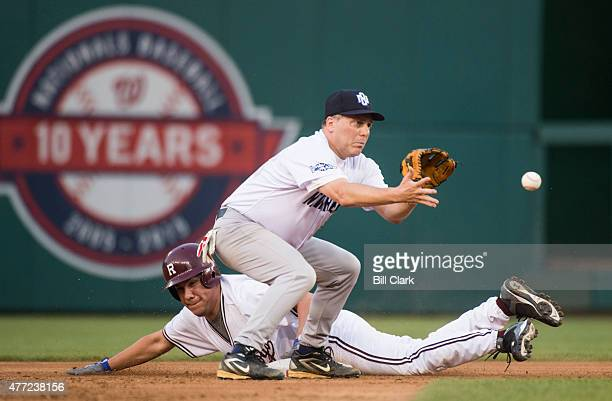 Rep Pete Aguilar DCalif safely steals second base as Rep Steve Scalise RLa waits for the throw during the 54th Annual Roll Call Congressional...