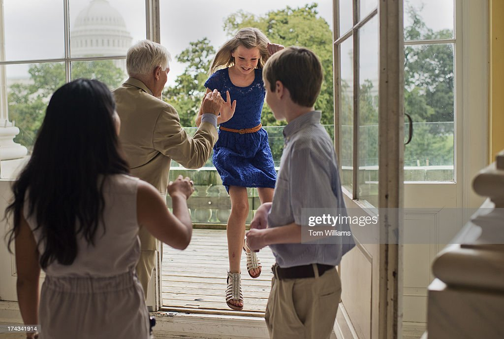Rep. Pete Sessions, R-Texas, high fives Cayla Canerbury, 11, of Flower Mound, Texas, after taking photos off off the Cannon rotunda.