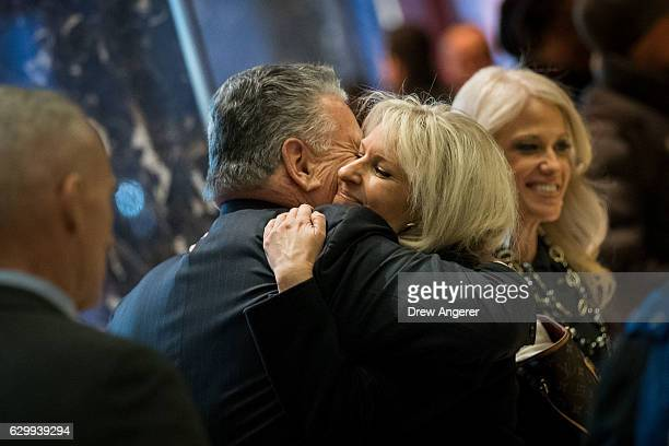 US Rep Peter King hugs Monica Crowley recently chosen as a deputy national security adviser in Presidentelect Donald Trump's administration as...