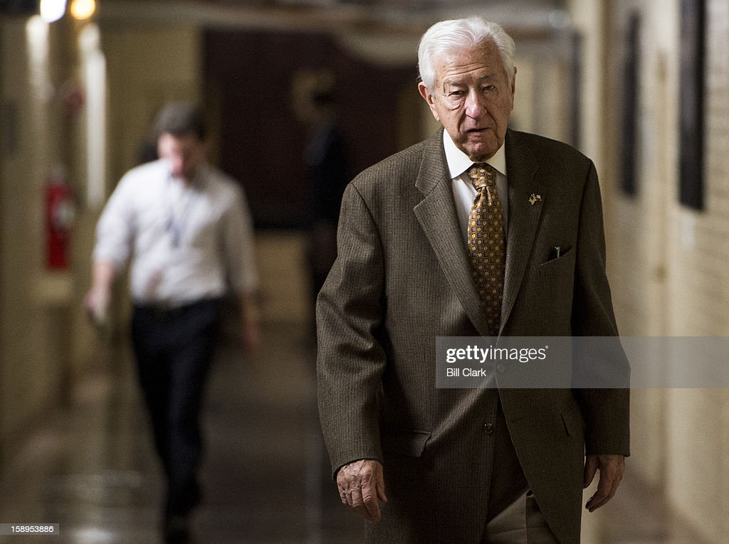 Rep. Ralph Hall, R-Texas, leaves the House Republican Conference meeting on Friday, Jan. 4, 2013.