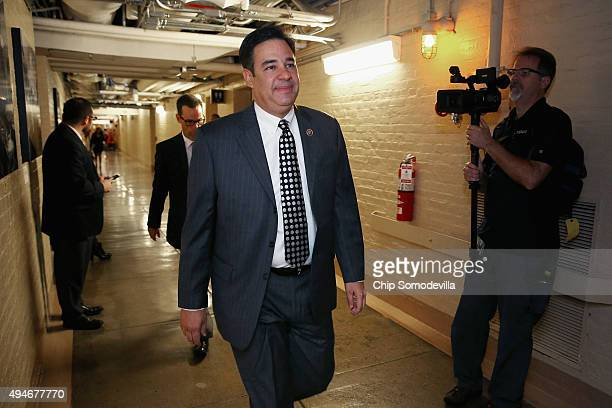 Rep Raul Labrador heads for a House GOP candidates forum at the US Capitol October 28 2015 in Washington DC Labrador is a member of the farright...