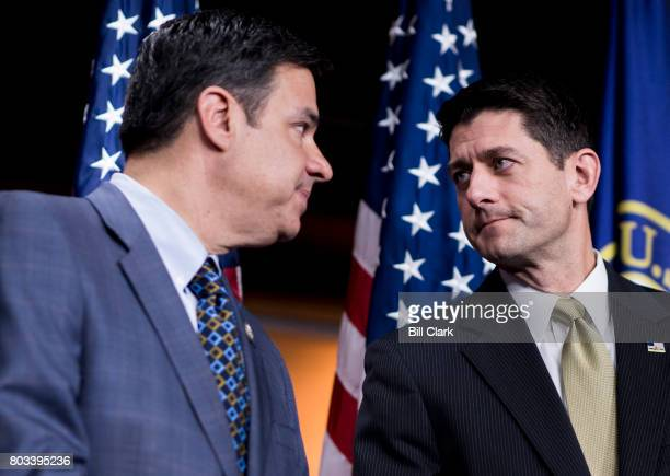 Rep Raul Labrador RIdao left speaks with Speaker of the House Paul Ryan RWisc during Ryan's weekly news conference in the Capitol on Thursday June...