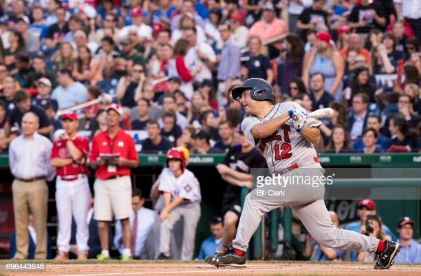 Rep Raul Ruiz DCalif takes a swing during the annual Congressional Baseball Game at Nationals Park in Washington on Thursday June 15 2017