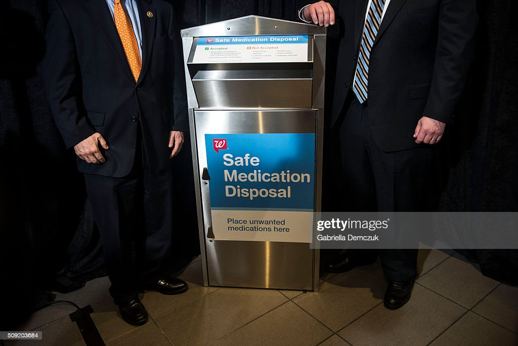 Rep. Robert Dold (R-IL), left, and Lake County (Ill.) State's Attorney Michael Nerheim, right, stand next to a Safe Medication Disposal box after an event unveiling a multi-state program to combat opioid abuse in the U.S. at a Walgreens store on February 9, 2016 in Washington, DC. More than 500 Walgreens drugstores will have safe medication disposal kiosks installed, and livesaving opioid antidote naloxone will be made available without prescription in 35 states throughout the U.S.