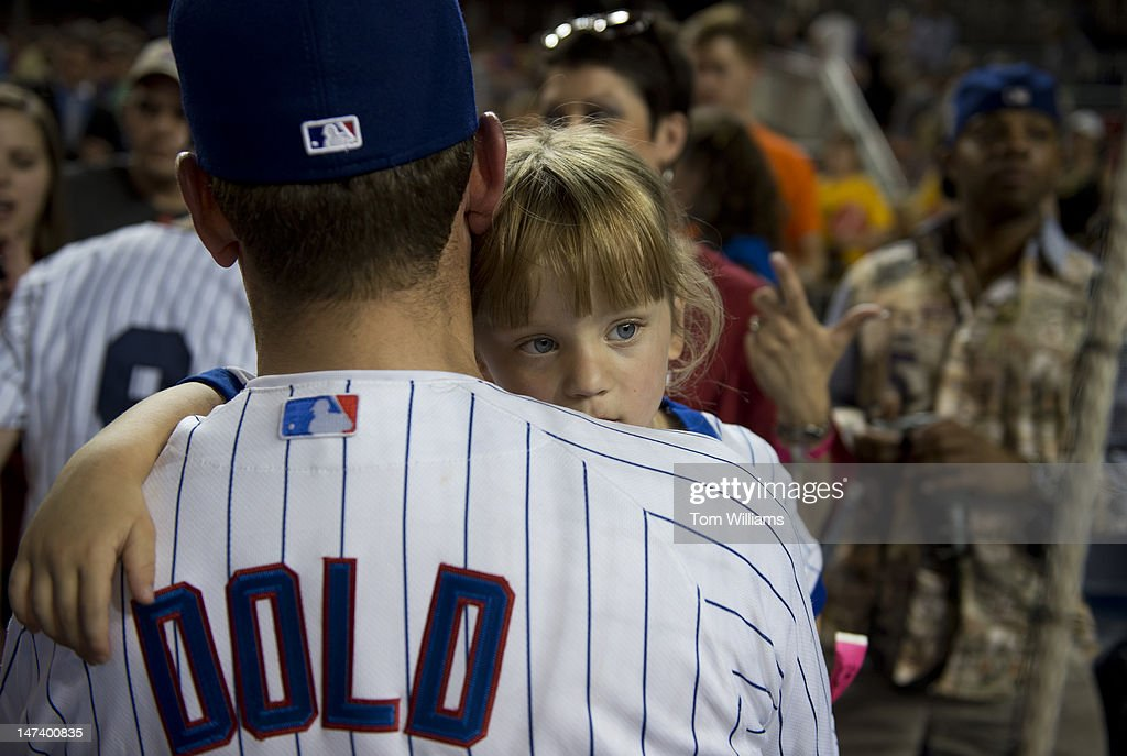 Rep. Robert Dold, R-Ill., holds his daughter Honor, 5, after the 51st Annual CQ Roll Call Congressional Baseball Game held at Nationals Park. The Democrats prevailed over the Republicans 18-5.