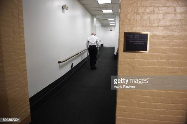 S Rep Roger Williams who suffered a legankle injury during last week's shooting during the congressional baseball practice moves on crutches to a...