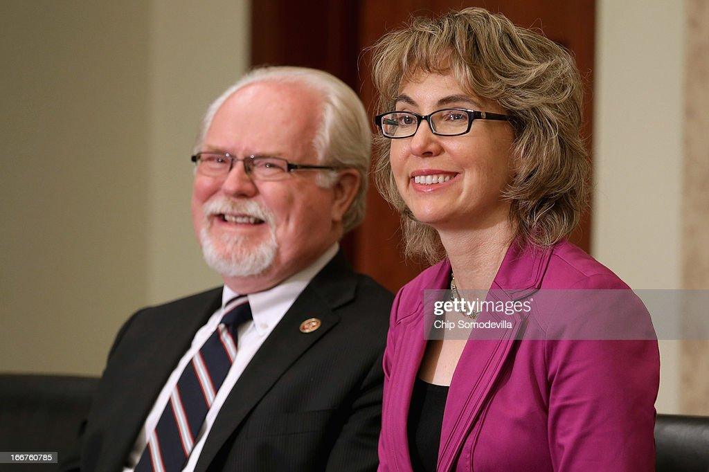 U.S. Rep. Ron Barber (D-AZ) (L) and former U.S. Rep. <a gi-track='captionPersonalityLinkClicked' href=/galleries/search?phrase=Gabrielle+Giffords&family=editorial&specificpeople=6961081 ng-click='$event.stopPropagation()'>Gabrielle Giffords</a> (D-AZ) attend the dedication ceremony of the Gabriel Zimmerman Meeting Room in the U.S. Capitol Visitors Center April 16, 2013 in Washington, DC. A member of Giffords' Congressional staff, Gabriel Zimmerman was murdered during a shooting spree January 8, 2011 that left six dead and 13 injured, including Giffords.