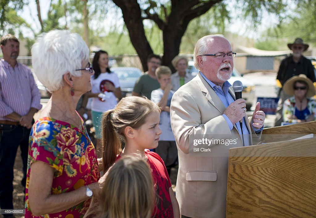 Rep. Ron Barber, D-Ariz., speaks as his wife Nancy and two of his grandchildren listen during his campaign rally with educators at Sam Hughes Elementary School in Tucson on Saturday, Aug. 9, 2014.