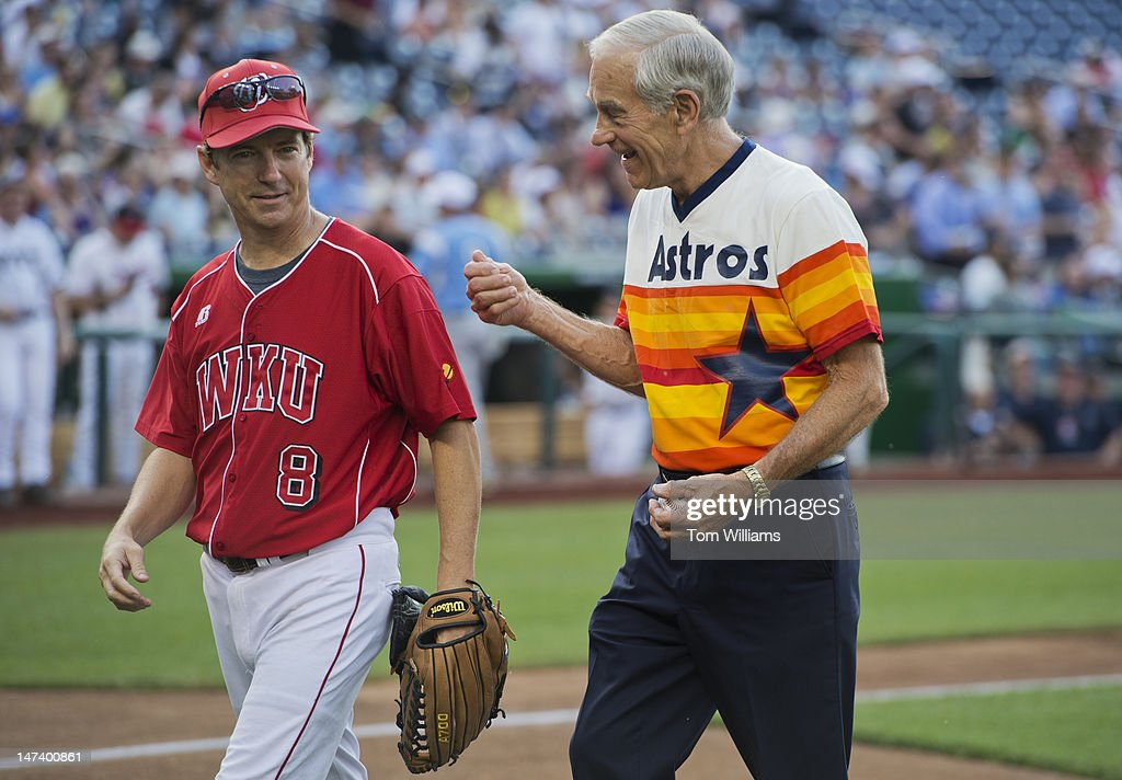 Rep. Ron Paul, R-Texas, right, and his son Sen. Rand Paul, R-Ky., walk to the dugouts after Rep. Paul was inducted into the CQ Roll Call Congressional Baseball Hall of Fame. The 51st Annual Congressional Baseball Game was held at Nationals Park and the Democrats prevailed over the Republicans 18-5.