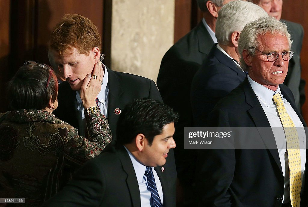 U.S. Rep. Rosa DeLauro (D-CT) (L) talks with U.S. Rep. Joseph Kennedy (D-MA) (2nd L), while his father former Congressman Joseph Patrick Kennedy II (D-MA) (R) stands nearby during the first session of the 113th Congress in the House Chambers January 3, 2013 in Washington, DC. House Speaker Boehner was re-elected as Speaker and presided over the swearing in of the newly elected members of the 113th Congress.