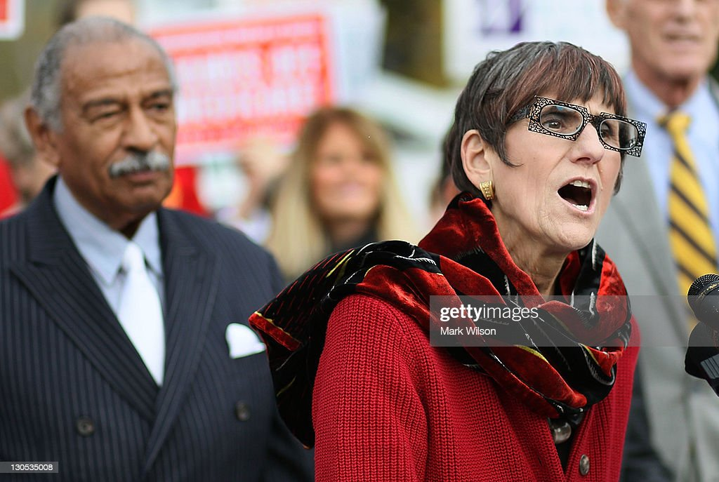 U.S. Rep. Rosa L. DeLauro (D-CT) (R) speaks while flan ked by U.S. Rep. <a gi-track='captionPersonalityLinkClicked' href=/galleries/search?phrase=John+Conyers&family=editorial&specificpeople=217823 ng-click='$event.stopPropagation()'>John Conyers</a> (D-MI) during a news conference at the U.S. Capitol October 26, 2011 in Washington, DC. Conyers called on the Joint Deficit Reduction Committee to preserve Medicare, Medicaid, and Social Security benefits when making their decision on cutting the deficit.