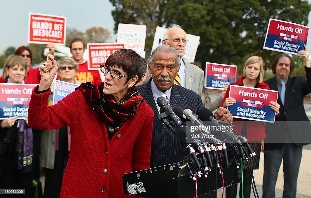 U.S. Rep. Rosa L. DeLauro (D-CT) (L), speaks while flanked by U.S. Rep. <a gi-track='captionPersonalityLinkClicked' href=/galleries/search?phrase=John+Conyers&family=editorial&specificpeople=217823 ng-click='$event.stopPropagation()'>John Conyers</a> (D-MI) during a news conference at the U.S. Capitol October 26, 2011 in Washington, DC.U.S. Rep. DeLauro and U.S. Rep. Conyers called on the Joint Deficit Reduction Committee to preserve Medicare, Medicaid, and Social Security benefits when making their decision on cutting the deficit.