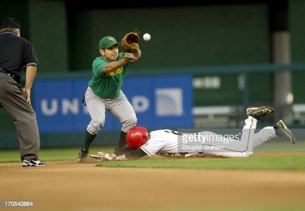 Rep Sam Graves slides safe into second base as Rep Paul Ruiz waits on the ball during the 52nd annual Congressional Baseball Game at National Stadium...
