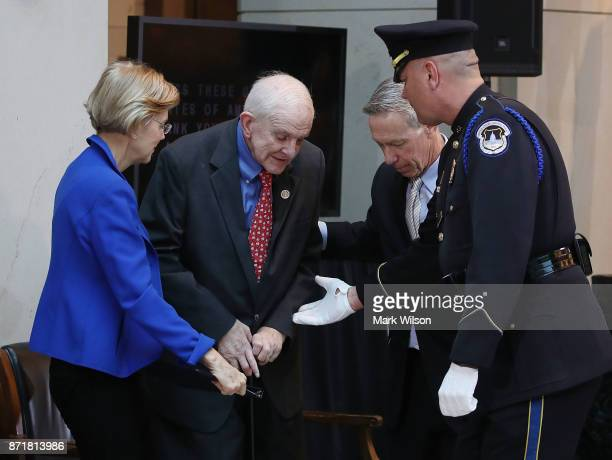 Rep Sam Johnson gets help walking during a ceremony to honor American prisoners of war and the nearly 83000 servicemen and women missing in action at...