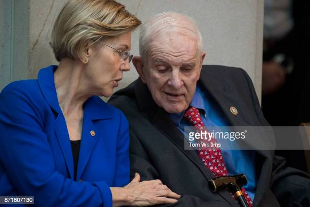 Rep Sam Johnson RTexas who was a POW in Vietnam and Sen Elizabeth Warren DMass attend a ceremony in Emancipation Hall to dedicate a chair to honor...