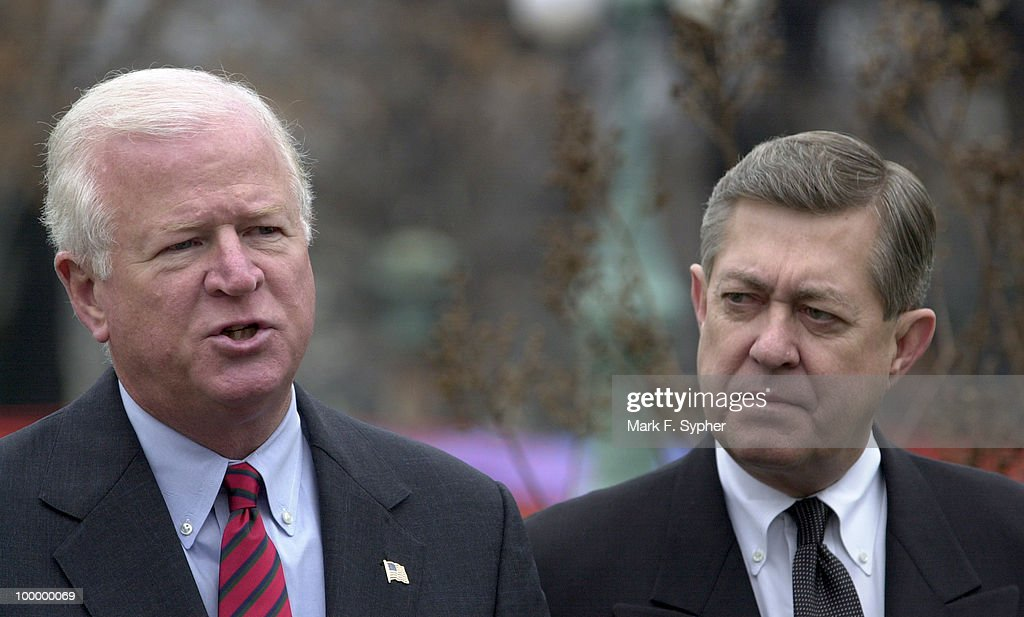 Rep. Saxby Chambliss (R-GA), left, joined fellow Georgia Rep. John Linder (R-GA) for a rainy news conference at the House Triangle on Tuesday morning that outlined the Center for Disease Control's need for funds for building repair and new site for additional buildings.