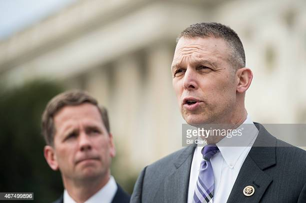 Rep Scott Perry RPa right and Rep Robert Dold RIll hold a news conference outside the Capitol on Wednesday March 25 to discuss the introduction of...