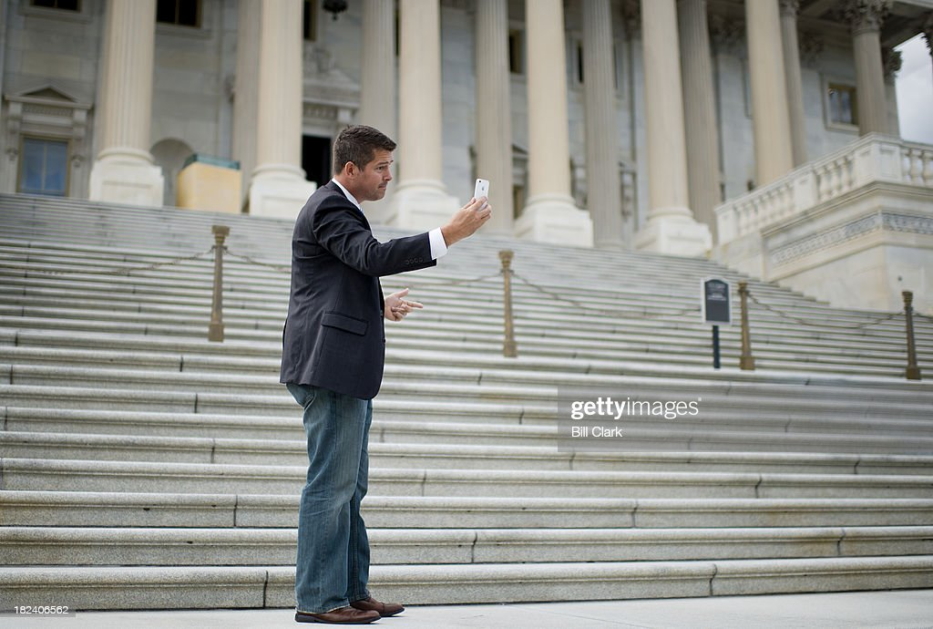 Rep. Sean Duffy, R-Wisc., shoots a video 'selfie' for his Facebook page on the Senate steps before the start of a House GOP news conference on the steps of the Senate calling on the Senate Democrats to take up the Continuing Resolution legislation on Sunday to avert the looming government shutdown.